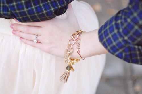 Gold tassel bracelet; love script bracelet
